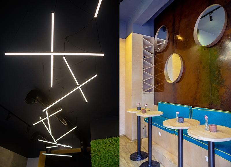 Wnętrze Tu'gether - lampy, stoliki, okrągłe lustra