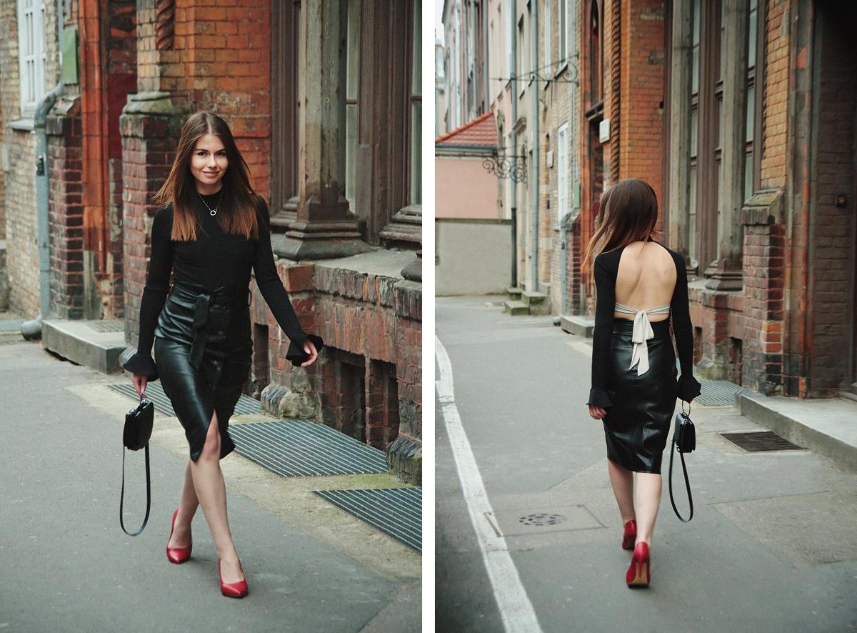 Kobieca stylizacja z czerwonymi szpilkami i skórzaną spódnicą